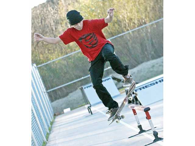 Jonathan Gale, 15, of Castaic, slides on a rail in the new skate park at the Castaic Sports Complex on Tuesday.