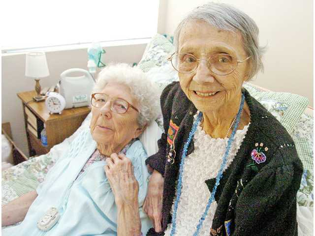 Marie Barnett, 104, right, poses with roommate Beverly Anderson, 83, at Pacifica Senior Living in Newhall on Friday. Barnett celebrated her 104th birthday at the assisted-living center last week. She attributes her longevity to a positive outlook and refraining from smoking and excessive drinking.