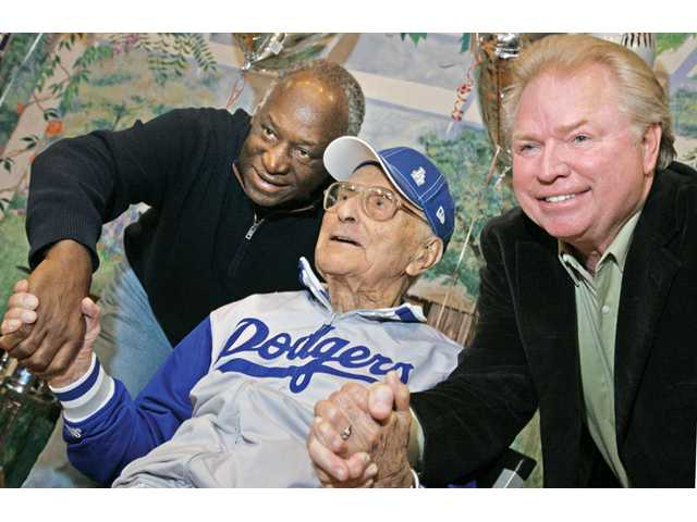 Former Los Angeles Dodgers Al Downing, left, and Bill Russell, right, meet with longtime Dodger fan Nick Corsinitas as he celebrates his 102nd birthday at the Santa Clarita Valley Senior Center in Newhall on Tuesday. For more photos and an article detailing Corsinitas' birthday, see Monday's Senior Living page.