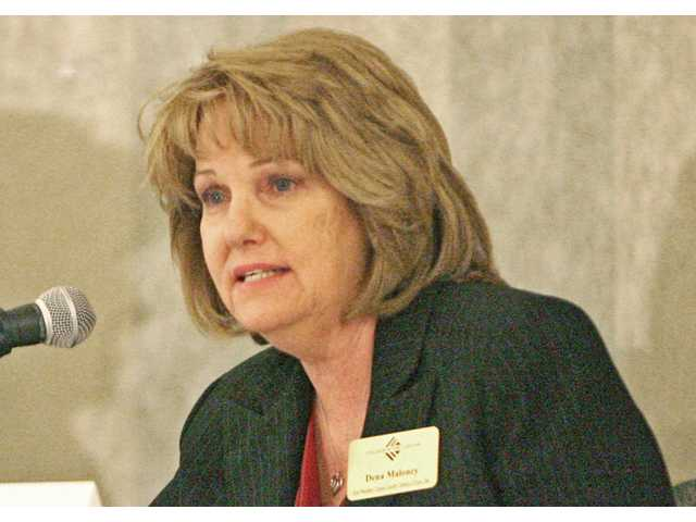 Dena Maloney, vice president of the College of the Canyons Canyon Country campus and vice president of economic development, speaks during a panel discussion at the Santa Clarita Valley Chamber of Commerce's quarterly business luncheon at the Hyatt Regency Valencia on Thursday. The event discussed local resources to help the SCV's business owners thrive as the economy continues its recovery from the Great Recession.