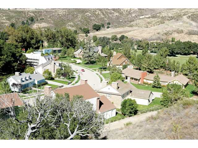A residential cul-de-sac with 13 homes sits ready for film and television production at Disney's Golden Oak Ranch, located on nearly 900 acres of land in Placerita Canyon.