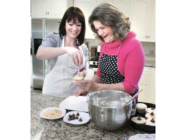 Megan from The Poached Pear and Merry Graham have fun making festive cupcakes.