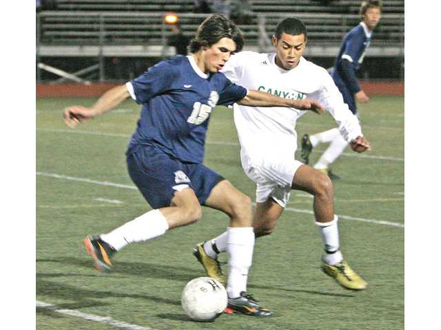 West Ranch midfielder Lucas Reilly, left, tries to find room past Canyon's Brandon Davy on Tuesday at Canyon High.