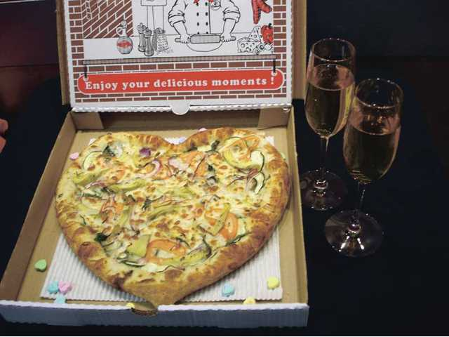 Why not try a heart-shaped pizza (here Tomato Joe's California Dreamin') and a beverage served in champagne glasses?