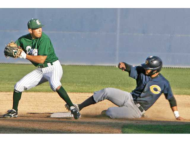 East Los Angeles College's Ruben Ramirez tags out College of the Canyons' Juan Perez on Friday at COC.