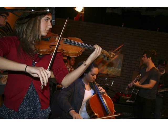"""Violinist Kelsey Kepple and cellist Keani Kahuhu add depth and breadth to the Johnny Strat Band's sound on a special edition of  """"House Blend,"""" premiering on SCVTV in Santa Clarita Saturday, Feb. 12, 2011."""