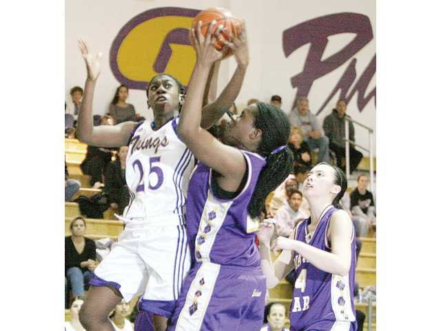Valencia forward Jennifer Anumba (25) and Diamond Bar's Yewande Alabi, center, battle for a rebound as Daphne Wang looks on Thursday at Valencia High School during the first round of the CIF-SS Division IA playoffs.