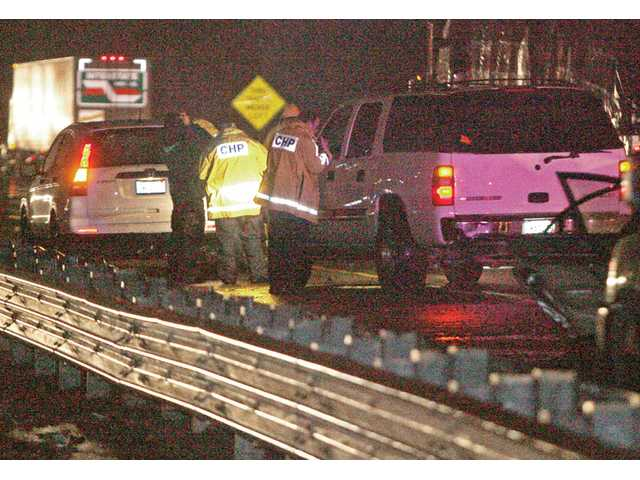 California Highway Patrol officers respond to a six-car collision on northbound Interstate 5 south of Magic Mountain Parkway on Friday night. As expected, a storm moving southbound from Seattle dumped an inch of rain in the Santa Clarita Valley, according to the National Weather Service observation station in the Newhall Pass.