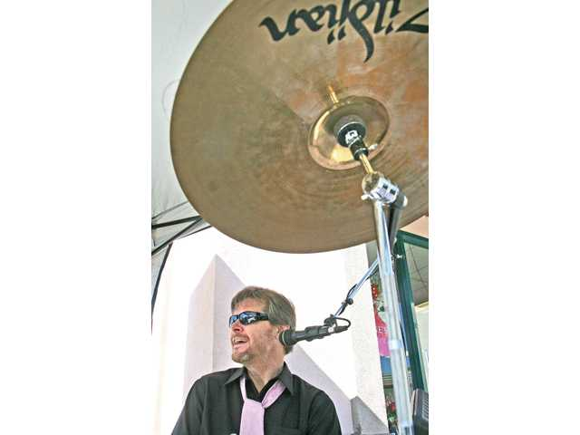 "Bedford Park drummer and vocalist Kenny Cetera performs ""Stand by Me"" as a special Valentine's Day treat for shoppers in front of designer-clothing store Labels SCV at the Promenade Shopping Center in Valencia on Monday."