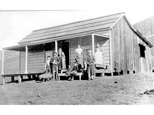 The Cordova family and their Castaic house around 1886. Young Jose Olme, on the far left, escaped the shooting in 1890 that killed his brother-in-law D. Cook, standing next to him.