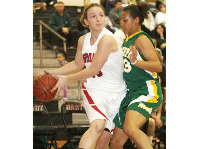 Hart's Mariah Glasshoff, left, looks to pass as St. Joseph's Tatiana Dunlap defends on Saturday at Hart High.