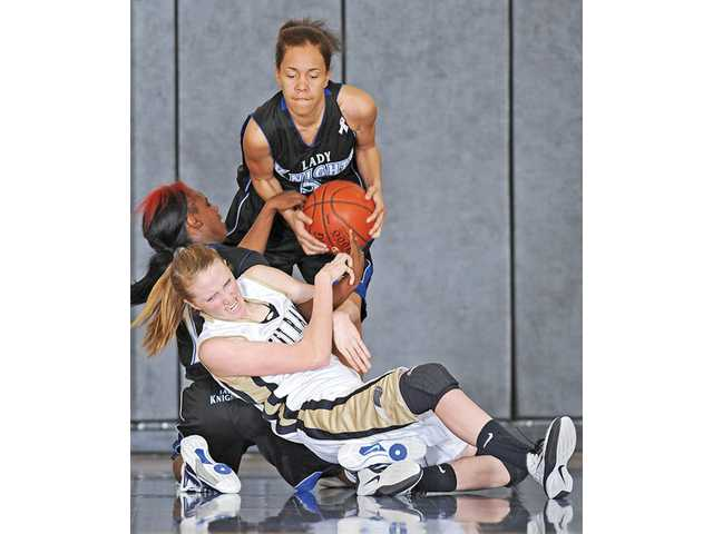 West Ranch's Hannah Green, front, fights for a loose ball with Rialto's Channe' Armstrong, left, and Brittani Walker on Saturday at West Ranch. The Wildcats lost 90-63.