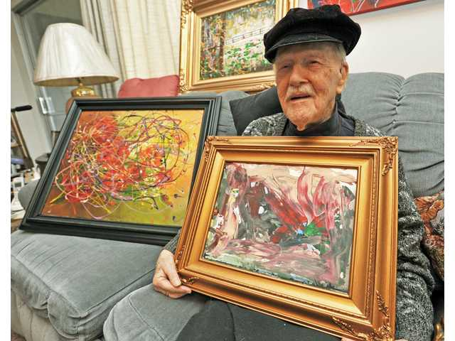 Harold Olov Wang, 99, sits with a few pieces of his artwork in his Friendly Valley home in Canyon Country. Due to unexpected home-care expenses, the near-centenarian is looking to sell pieces to avoid a foreclosure on his house.