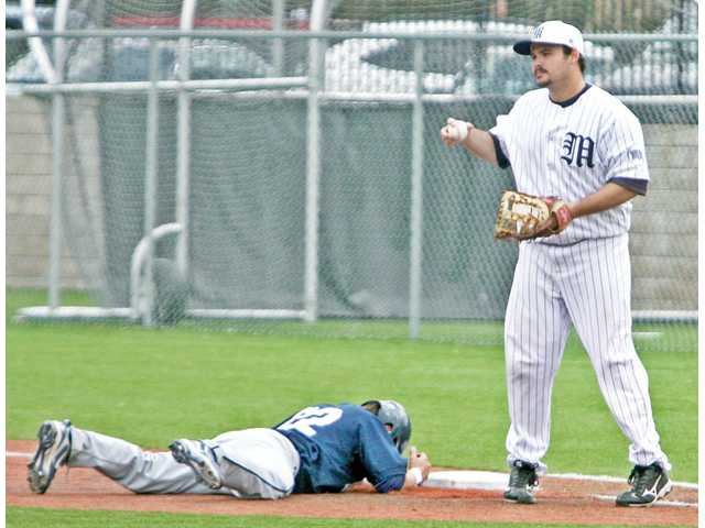 San Diego Christian's Sean Sweeney, left, puts his head down after being tagged out by TMC first baseman Jared Otto on Thursday at Reese Field.