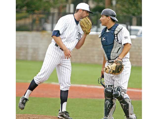 The Master's College starting pitcher Charlie Gillies, left, and catcher Chris Talley converse on Thursday at Reese Field.