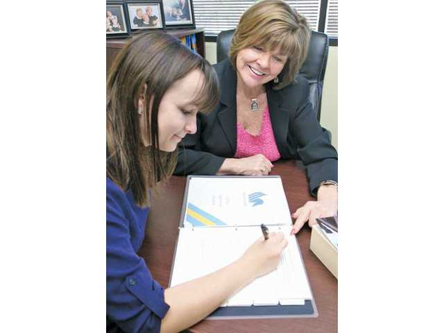 Samantha Summers, 17, works on her college-application portfolio with Pegasus2edu owner Peggy Stabile at the company's Valencia office on Feb. 3.
