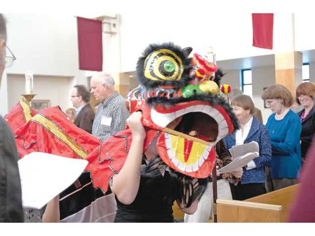 One of the two parishioners dressed as a traditional Chinese lion dances in the procession during the recent ordination ceremony for the Rev. Susan Bek and the Rev. Dr. Cynthia Jew at St. Stephen's Episcopal Church in Valencia. The celebration included flags, banners, the lions, incense, four choirs, lots of clergy, one bishop, four chalice bearers and 12 acolytes.