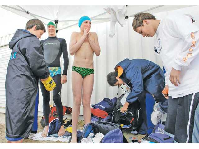 Members of the Ice Packs from the Canyon Aquatics group prepare to enter the water of Castaic Lake for the Polar Plunge on Saturday.