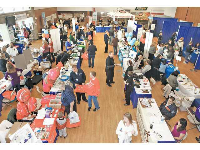 Wellness Expo vendors and visitors line the cafeteria floor at College of the Canyons on Saturday.