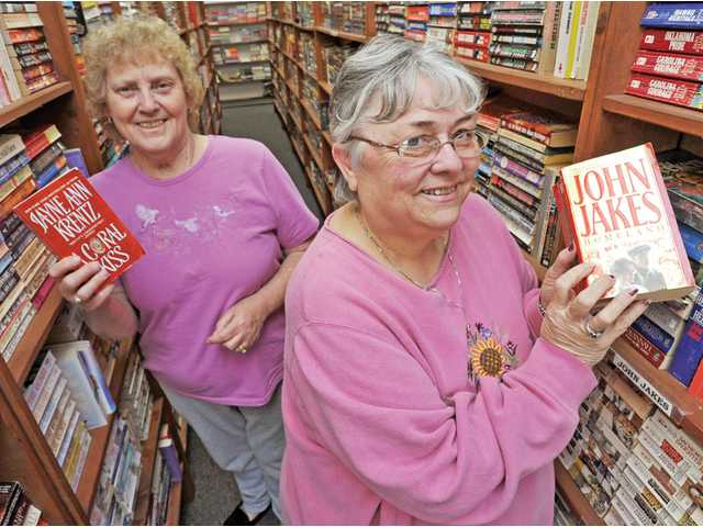 Charrie Eckert, left, and Janie Kopecky are owners of Paperback Emporium in Canyon Country, which is celebrating its 30th year of operation. The local, independent used-book seller carries nearly all genres, including Westerns, thrillers and historical romances, among others.