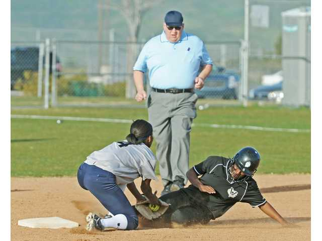 Notre Dame's Melanie Allegretti, left, tags Golden Valley's Erika Esparza at second base in the second inning on Friday at Golden Valley High.