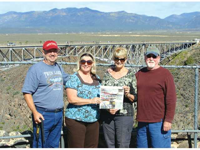 From left, Jim and Linda Sinclair with Marylu and Jim Allen, of Valencia, took a camping trip this past October with several other couples and stopped at the Rio Grande Gorge Bridge in Santa Fe, N.M. The group were on its way to the annual Albuquerque International Balloon Fiesta.