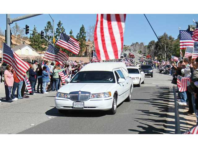 Locals show support during a procession in March 2010 for Sgt. Ian T.D. Gelig, of Stevenson Ranch, who was killed in Afghanistan. Gelig's family held a large celebration of his life Saturday.