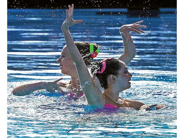 Joanna Langer, 13, left, and Remy Mink, 13, of Walnut Creek, perform in duet category competition at the 2011 U.S. Synchronized Swimming West Zone Finals held at the Santa Clarita Aquatic Center in Santa Clarita on Saturday.