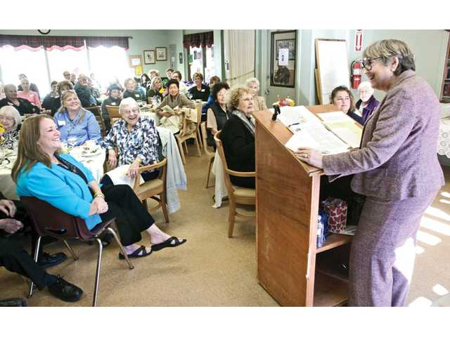 "Author and cancer survivor Judith Harris, right,  speaks at the American Cancer Society Survivor's Tea held at the Santa Clarita Valley Senior Center recently. Harris, a breast cancer survivor, was able to shed a humorous light on her story. ""The longer you live, the more things happen. Once you become elderly, you survive damn near everything,"" Harris said."