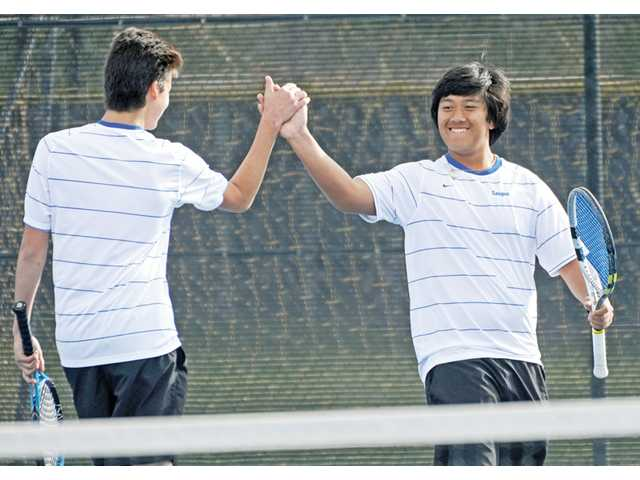 Saugus' doubles team of Josh Hill, left, and Kevin Okimoto celebrate after a point against Quartz Hill Monday at Saugus High.