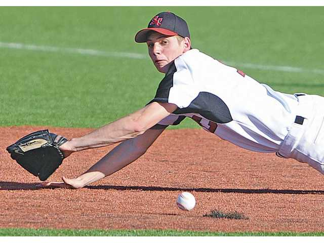 Santa Clarita Christian first baseman Trent Garrison dives to stop a ground ball against Frazier Mountain on Wednesday at Reese Field at The Master's College. SCCS lost 12-6.