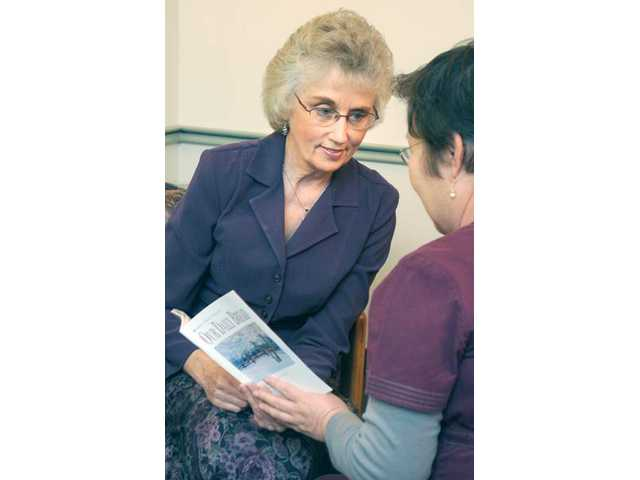 Margery Link, a chaplain for Henry Mayo Newhall Memorial Hospital, meets with a patient seeking spiritual comfort. Link has served as a volunteer for nearly 19 years.