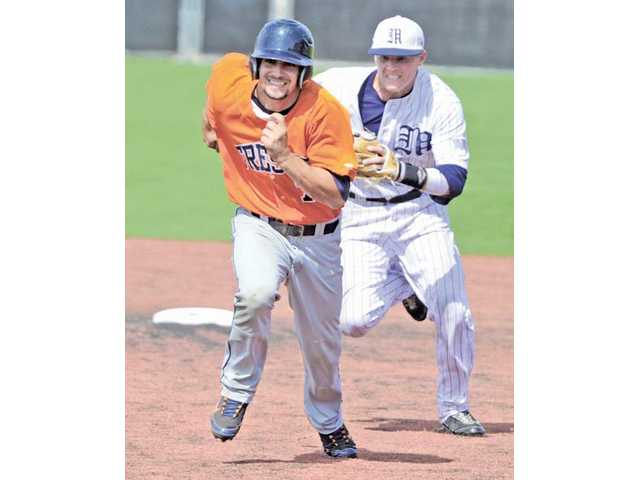 The Master's College second baseman Ben Ives, right, runs down Fresno Pacific's Tyler Pryor (7) at TMC on Saturday.
