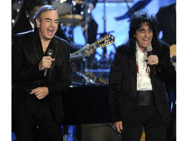 Inductees Neil Diamond, left, and Alice Cooper perform at the Rock and Roll Hall of Fame induction ceremony, Tuesday, March 15, 2011 in New York.