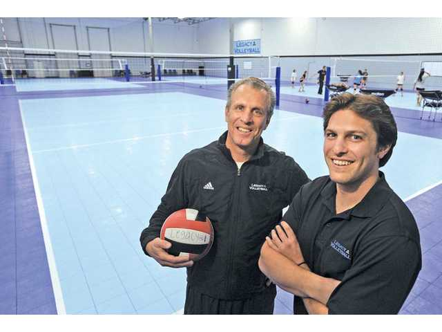 Legacy Volleyball Club founder Walt Ker, left, was the driving force behind the construction of a new 19,000-square-foot facility for the club in Valencia. His oldest son Tony, right, is one of the nearly 30 coaches employed by Legacy.