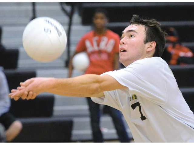 Golden Valley outside hitter Alec Schlossman bumps a ball against Burroughs on Tuesday at Golden Valley High.