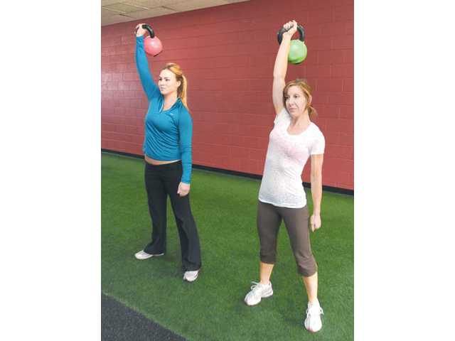 Strength training, such as overhead presses with heavy dumbbells, combats skinny fat.