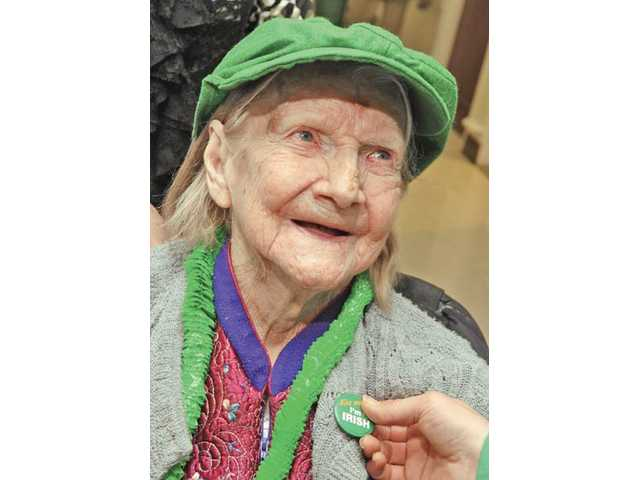 "Resident Margrete Tibbetts gets a ""Kiss me I'm Irish"" button."