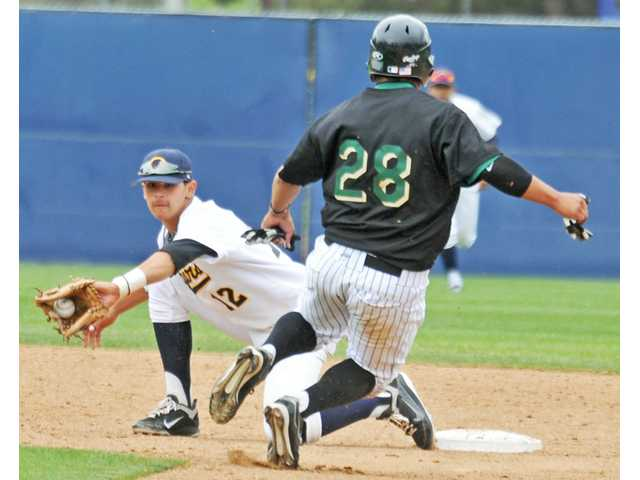College of the Canyons shortstop Juan Perez fields the ball as he prepares to tag out Los Angeles Valley College's Robert Gonzalez in the sixth inning on Saturday at COC.