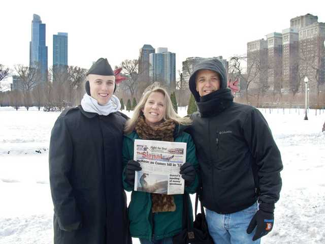 Maureen Patton, center, stands with her husband, Bob Patton, right, and son Kenneth R. Patton in Chicago, Ill. Maureen and Bob flew to Kenneth's graduation from the Naval Service Training Command in Great Lakes, Ill., and traveled to Chicago.