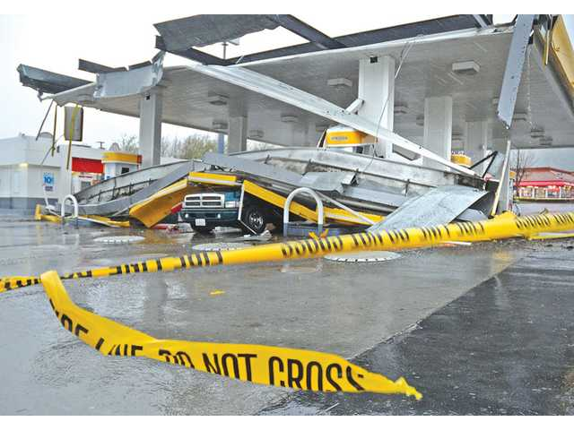 Heavy winds and rain caused a portion of a Shell gas station roof to collapse on a Dodge Ram 1500 Sport parked at a pump in Castaic on Sunday. The National Weather Service forecast rains to taper off this morning, leaving scattered showers this afternoon. No rain is expected Tuesday, but Wednesday and Thursday may have intermittent showers increasing during the evenings.
