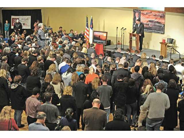Pastor Scott Basolo leads the hundreds in attendance in prayer at a memorial for fallen soldier Rudy A. Acosta, which was held in the gymnasium at Santa Clarita Christian School in Canyon Country on Thursday night.