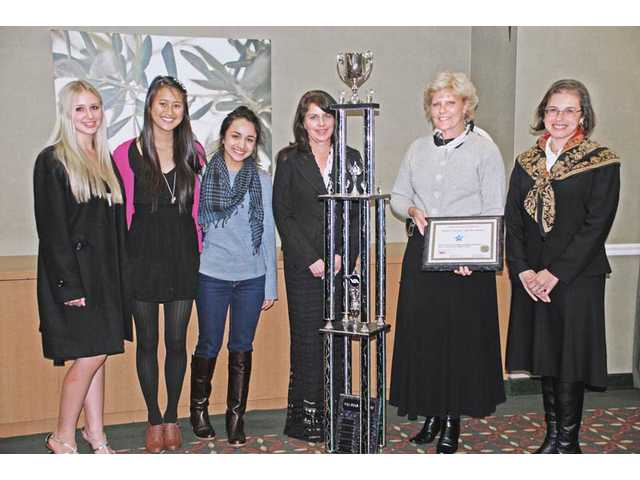 "West Ranch High School students won the VIA Star business competition with their program ""Project Prom,"" providing senior prom formal attire to disadvantaged students. From left: Nicole Lowry, Ellen Jang, Anisa Siddiqui, teacher Linda Cox, Assistant Principal Debra Warren and Diana Meyer, VIA Star chair and president of Meyer Marketing Intelligence."