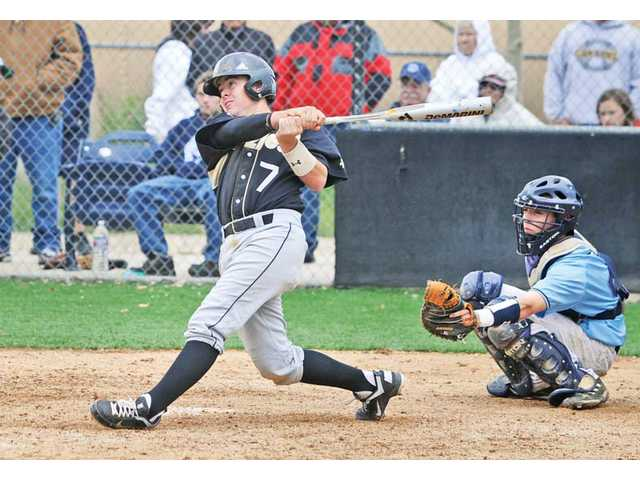 Golden Valley catcher Rocky Sherwood (7) hits an RBI single in the fifth inning against Saugus on Saturday at Saugus High School. Golden Valley won the game 8-7.