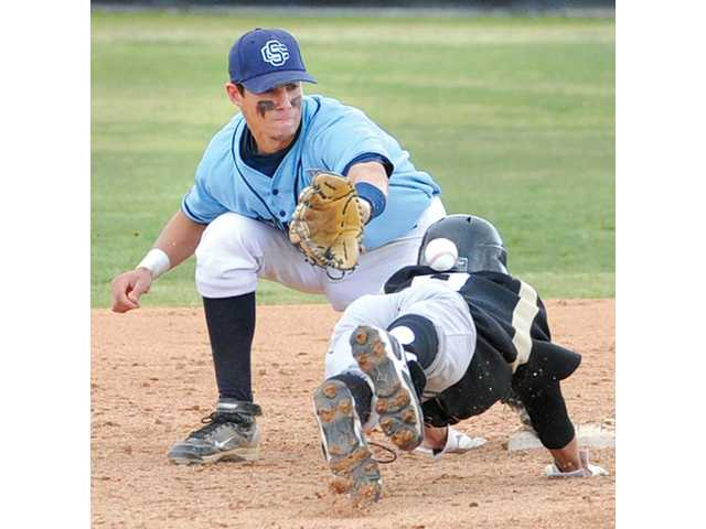 Golden Valley sophomore Ryan Alvarez, right, dives into second base to beat the throw as Saugus senior Nick Lombardi prepares to apply the tag on Saturday at Saugus High.