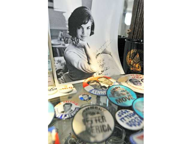 An autographed photo of Jacqueline Kennedy and political buttons are among the more than 20,000 pieces of memorabilia that Pat and Max Hobbs, of Canyon Country, have collected over the years.