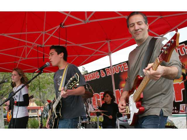 From left, singer Breanna Harris, 13, singer/guitarist Jakob Martinez, 13, drummer Zayne Martinez, 11, and bassist and Gigmasterz instructor David Lemasters called their band The Rock Poets at Route 66 Classic Grill on Sunday.