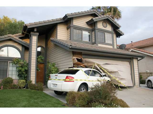 Car lodged in home after alleged drunk driving crash