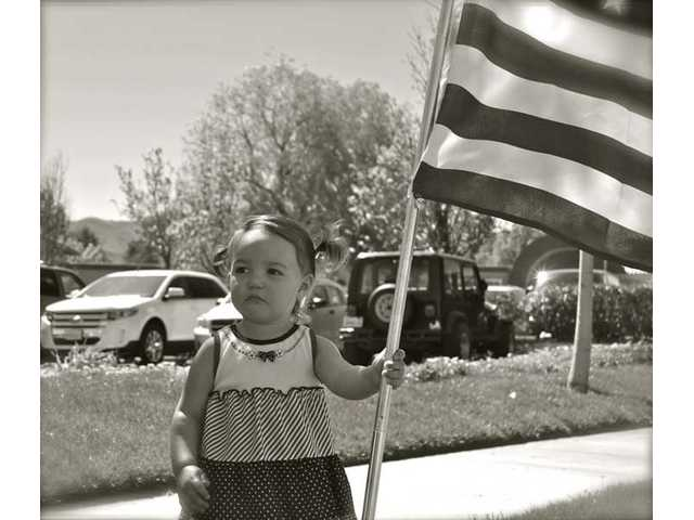 Madisyn Cervantes, 1, or Canyon Country, was among the youngest local residents lining Soledad Canyon Road in Canyon Country for Spc. Rudy A., Acosta's funeral procession on Thursday afternoon.
