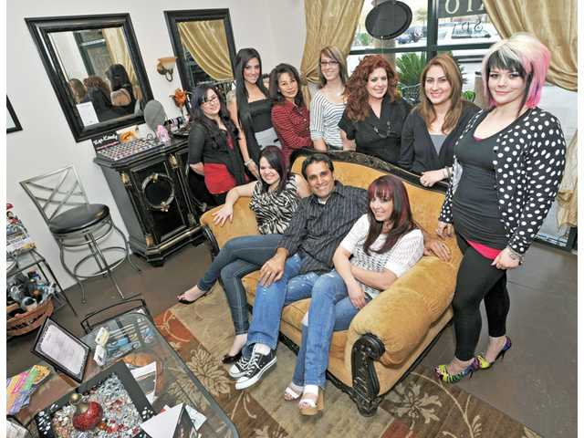"Nick Nejad, center, on couch, poses with several members of Valencia's Concerto Salon staff, all of whom are enjoying the salon's new look and feel after appearing on Bravo's ""Tabatha's Salon Takeover."" The TV show aired in February."